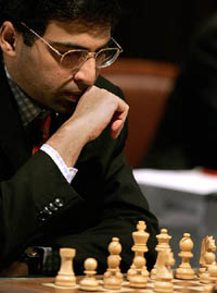 Anand from India studies the board against Topalov from Bulgaria during chess tournament in Sofia